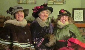 Emily Race, Tess Hoffman, and Shelia Race in caroling garb. Click for bigger photo.