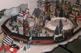The Garafano family's Christmas Village consists mostly of Dept. 56 buildings and accessories.  It also includes the first train Bachmann made to go with Dept. 56 houses. Click to see the whole photo.